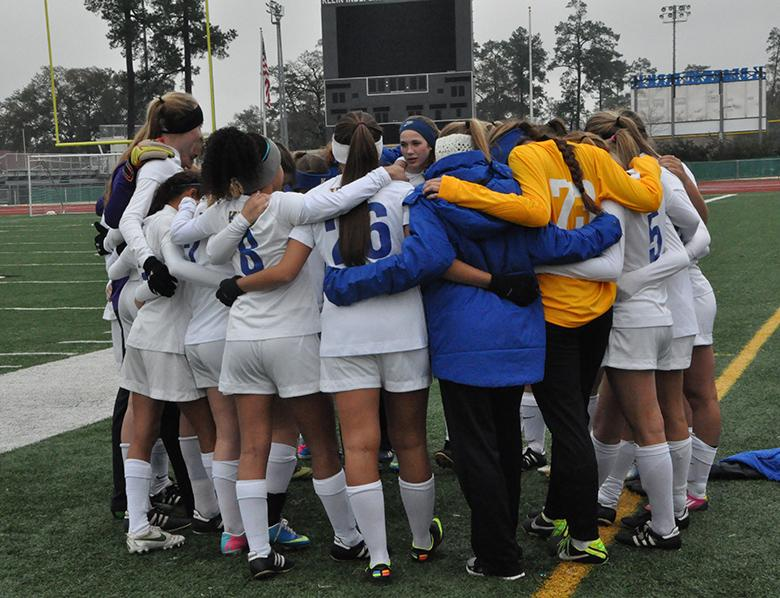 Varsity+girls+gather+in+a+huddle+during+the+March+4+game+against+Dekaney.+