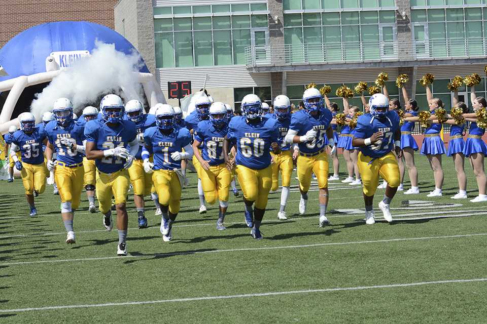 The Klein High School Varsity Team gets ready for a game