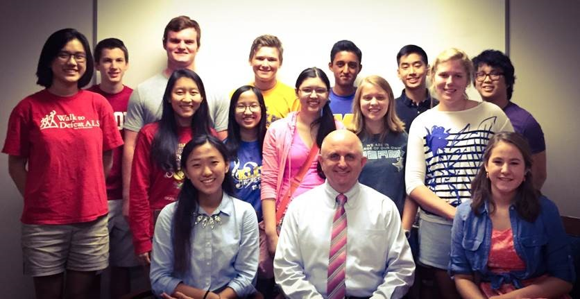 The 2015-2016 National Merit Semi finalists and Commended Students pose with Principal Larry Whitehead.