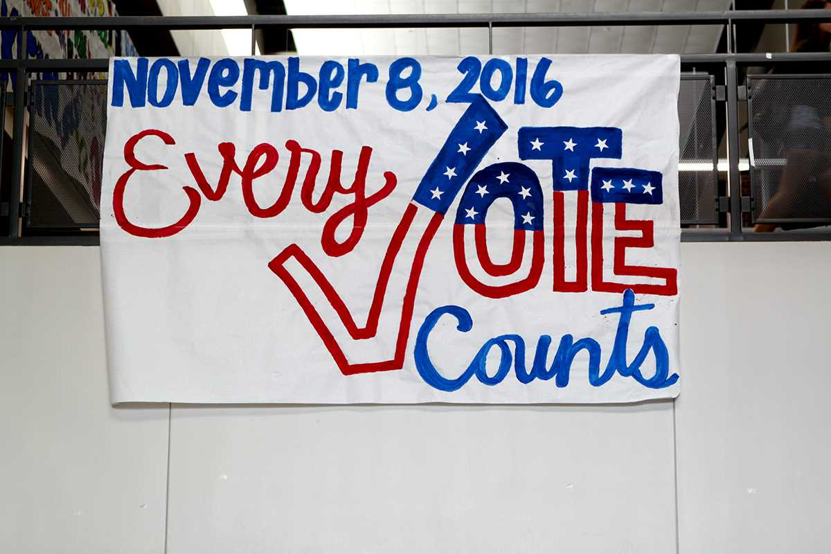 A reminder that every vote counts is displayed on a sign on Main Street.