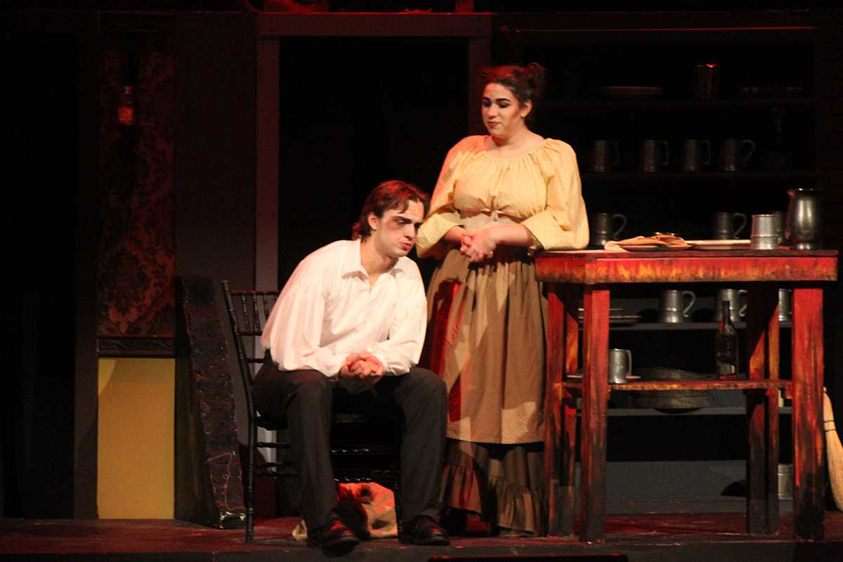 Seniors Ian Tomroy and Lauren Domino act out a scene in Sweeny Todd.