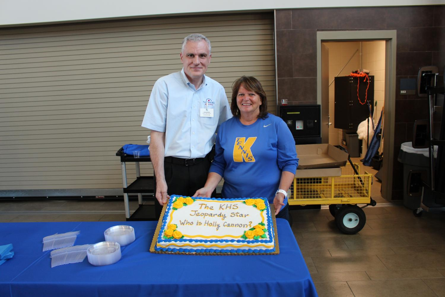 Holly Cannon receives a cake from Farmer's Insurance during her watch party in May.