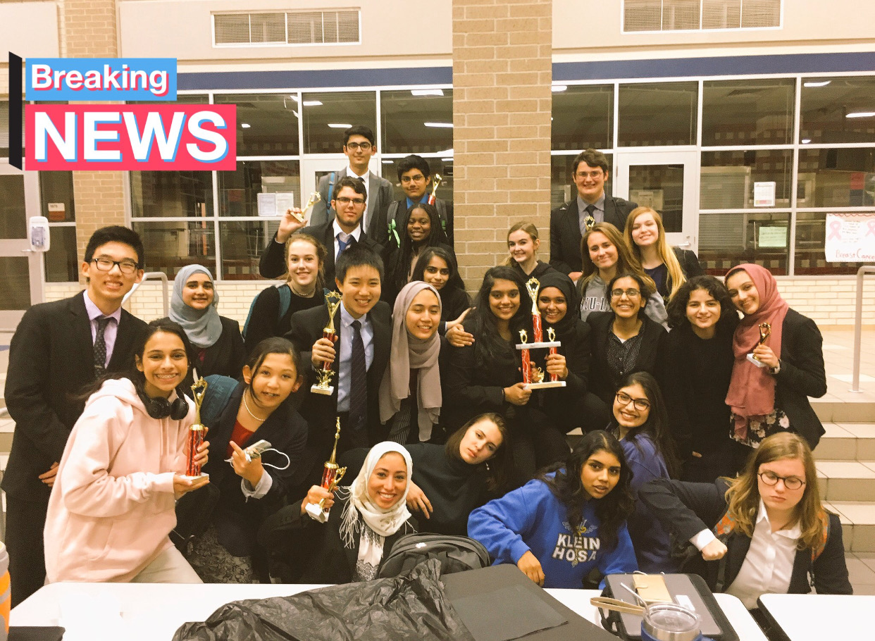 Debate sweeps Cy-Lakes, and gathers to take a photo.