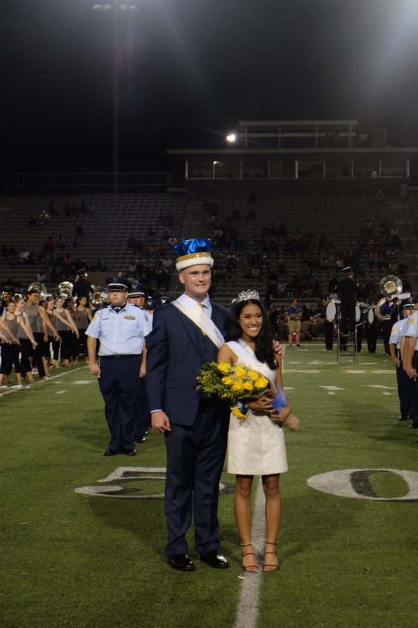 Seniors+Andrew+Hebert+and+Andreana+DeGuzman+pose+after+being+crowned+Homecoming+King+and+Queen