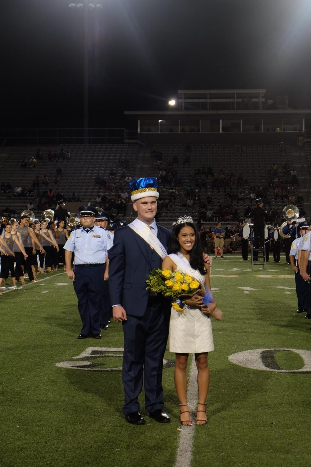 Seniors Andrew Hebert and Andreana DeGuzman pose after being crowned Homecoming King and Queen