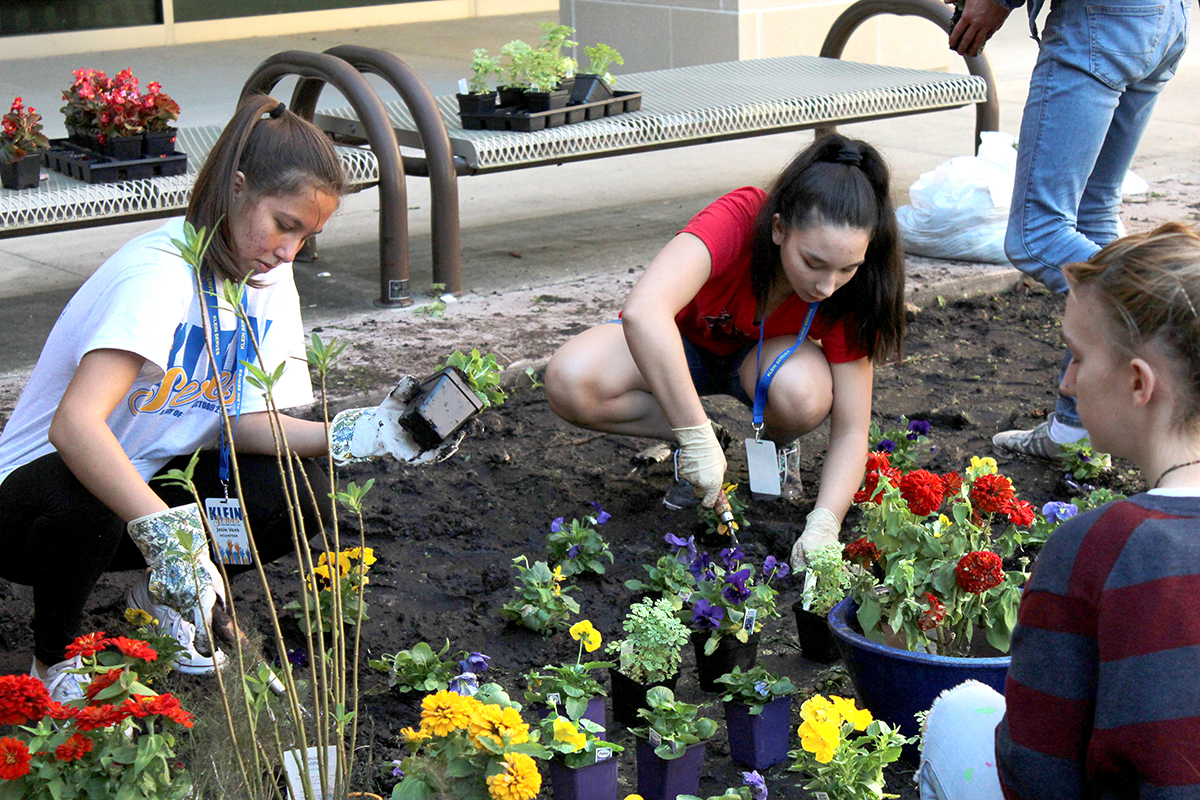 Earth Club Members work on the Butterfly Garden on Saturday October 27 as part of Klein Serves.