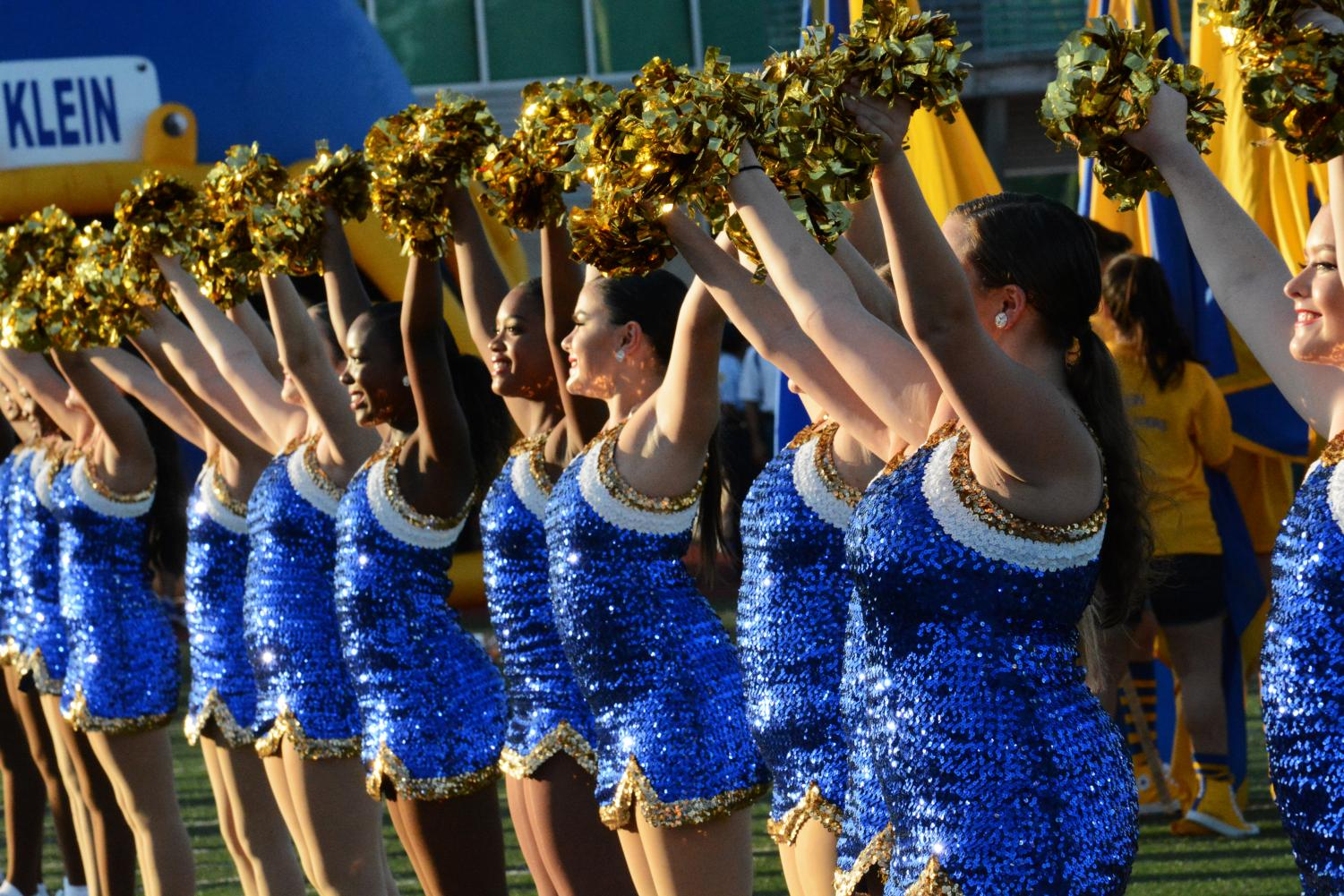 Bearkadettes perform during halftime at a football game.