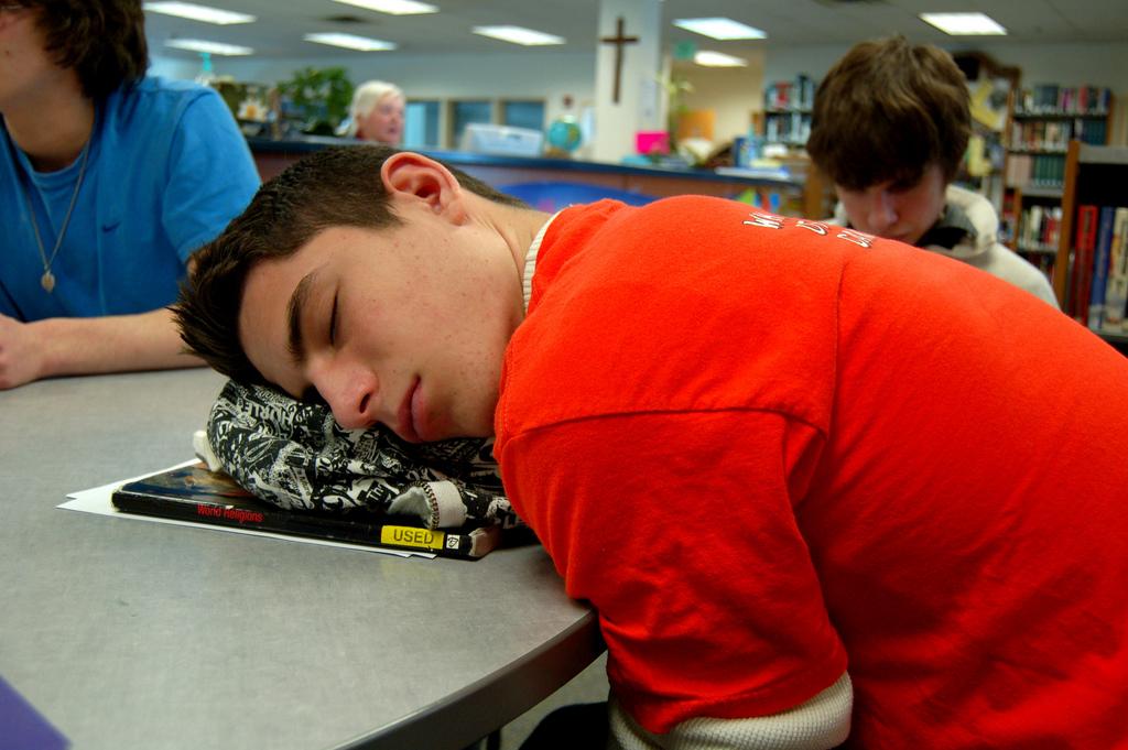 Teen sleeping in school