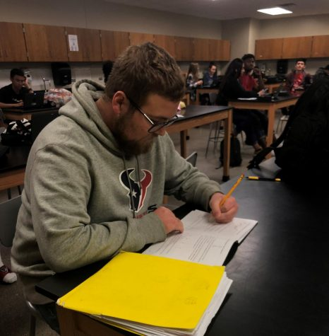 Senior Brandon McMasters works on an assignment as class occurs.