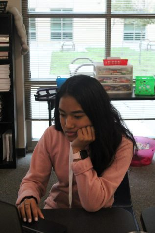 Senior Andy DeGuzman studies on her tablet during class.