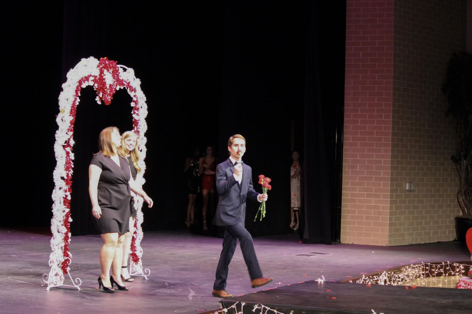 Senior+Alek+Jordan+kisses+a+flower+before+throwing+it+to+the+crowd.