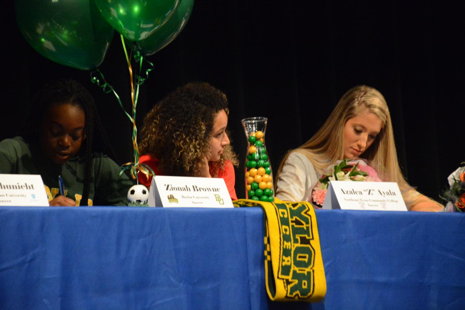 On College Signing Day in February, several seniors show their commitment to collegiate sports.