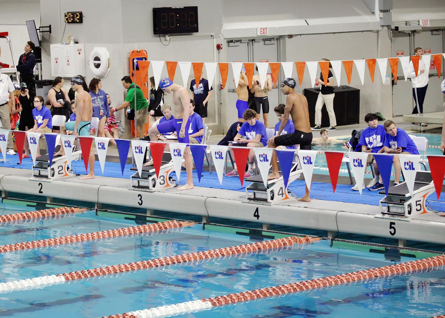 Swimmers+stepping+up+to+the+diving+boards.