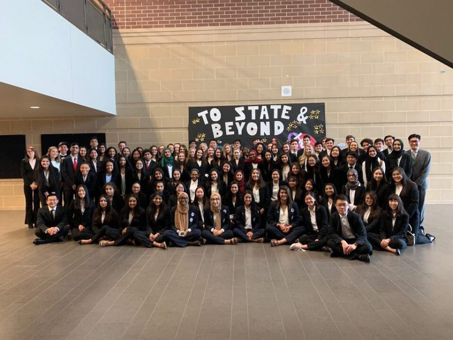 HOSA+gathering+in+front+of+their+poster+before+their+state+competition.