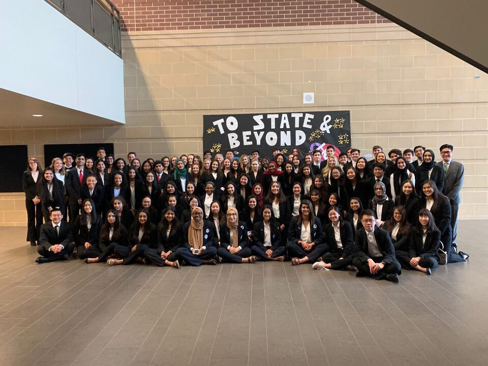 HOSA gathering in front of their poster before their state competition.