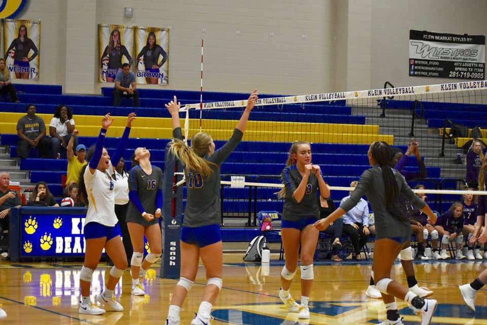 Throwing their hands in the air,The Bearkats celebrate after their win.