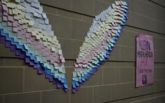 A pair of wings made of different colored sticky notes, made by Klein High Students during the Mental Health Awareness Fair