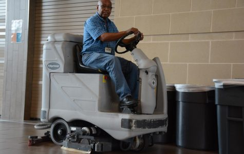 Head Custodian Larry Shaw cleans the cafeteria after the last lunch