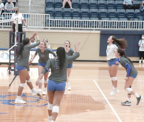 The volleyball team celebrates after advancing to the state championship game Tuesday. They defeated Flower Mound in 3 straight sets .