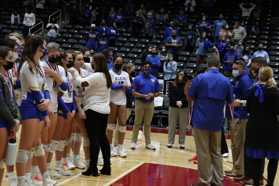 Members of the varsity volleyball team receive their silver medal at the 6A UIL State Championship game in Garland on Dec 12.