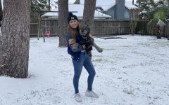 Junior Melanie Charron in her backyard covered in snow