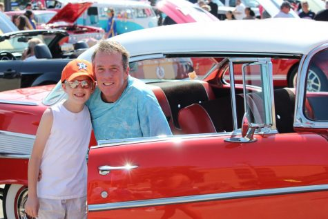Father and son smile for the camera at Klein Band Car Show.